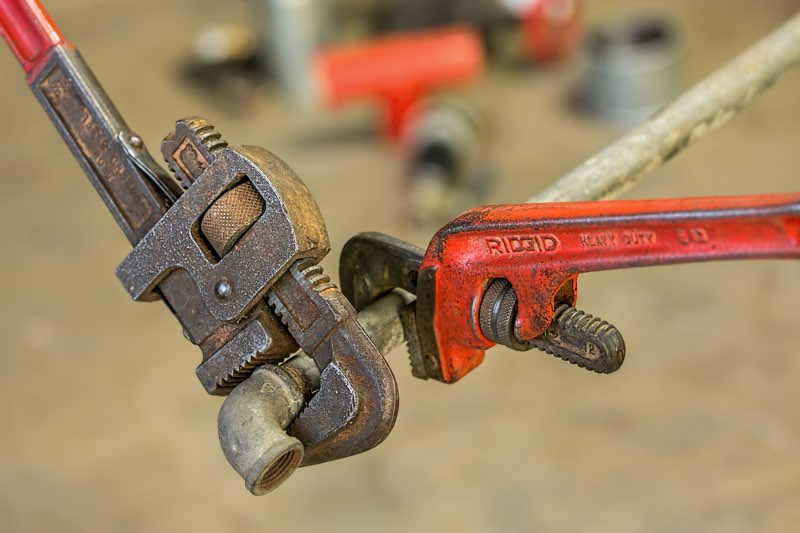 wrenches on gas line pipe